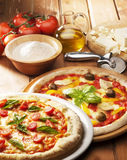Pizza with ingredients Stock Photography