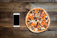 Pizza, Italian food delivery, call or order online on mobile, cellular, smart phone. stock image