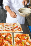 Pizza is an Italian restaurant that is popular around the world cooked by chefs who are capable of doing the dishes cooked with to Stock Photography