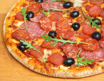 Pizza with Italian Salami Stock Images
