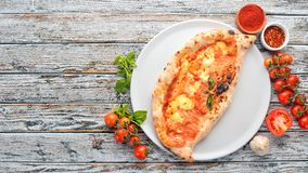 Pizza. Italian traditional dish. On a wooden background. Top view. Free copy space royalty free stock photos