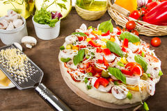 Pizza just before baking Royalty Free Stock Photography