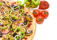 Pizza, ketchup and olives on a white background close-up. Pizza with vegetables and mushrooms, olives and ketchup on a white background close-up. horizontal Royalty Free Stock Photo
