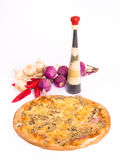 Pizza and kitchen decoration. Fresh hot pizza with tons of cheese and dried decoration on white background royalty free stock photos