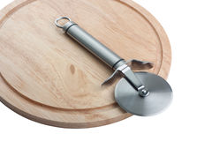 Pizza knife on a wooden cutting board Royalty Free Stock Image