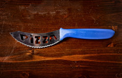 Pizza knives  on dark wooden table. Top view Royalty Free Stock Image
