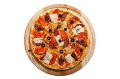 Pizza on light wooden background top view Royalty Free Stock Photo