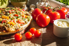 Pizza made ​​with fresh tomatoes. On old table stock image
