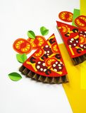 Pizza made from Craft paper. Ingredients for cooking. Processed cheese and tomatoes. View from above. White background. Party for a children`s party vector illustration