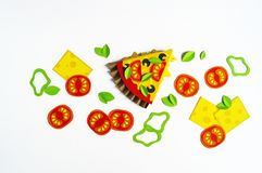 Pizza made from Craft paper. Ingredients for cooking. Processed cheese and tomatoes. View from above. White background. Party for a children`s party royalty free illustration