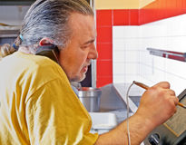 Pizza Maker taking phone order Royalty Free Stock Image