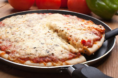 Pizza margarita in a frying pan Royalty Free Stock Photos