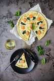 Pizza Margherita on black stone background. royalty free stock photography