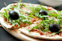 Pizza Margherita Closeup with Fresh Arugula Leaves royalty free stock photography