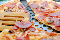 Pizza Margherita CloseUp. Thinly sliced pepperoni Stock Images