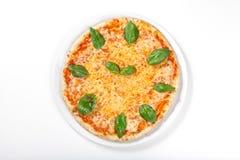 Pizza Margherita en el fondo blanco Fotografía de archivo libre de regalías