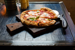 Pizza Margherita freshly baked on a table in cafe Royalty Free Stock Photography