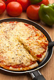 Pizza Margherita ( Margarita ) with a slice lifted up Royalty Free Stock Images