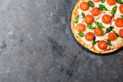 Pizza Margherita with mozzarella cheese, basil and tomatoes Traditional italian food. Classic recipe. Top view stock photos