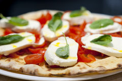 Pizza Margherita in a Restaurant. Summer edition of a Pizza Margherita stock photography