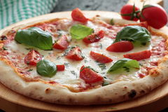 Pizza Margherita with tomato and basil Stock Images