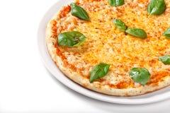 Pizza Margherita on white background Stock Photos