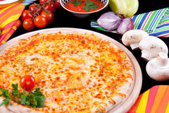 Pizza Marguerita. Delicious Pizza Marguerita with mozarella and tomato sauce Royalty Free Stock Images