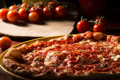 Pizza marinara with garlic and tomatoes on wooden paddle Royalty Free Stock Photography