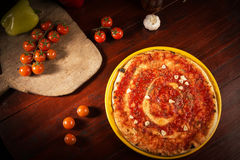 Pizza marinara with garlic on wooden table. Pizza with marinara sauce and garlic on wooden table royalty free stock photography
