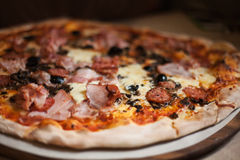 Pizza with meat, bacon, cheese Royalty Free Stock Photography