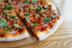 Pizza with meat and barbecue sauce Royalty Free Stock Image