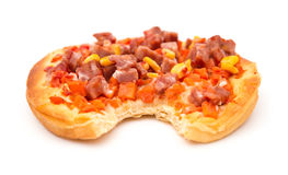 Pizza with meat maize and carrot with a bite on white Stock Photo