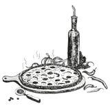 Pizza med flaskan av vitlökolja. Royaltyfri Bild