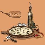 Pizza med flaskan av vitlökolja Arkivbilder