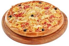 Pizza med skinka och ananas Arkivfoton