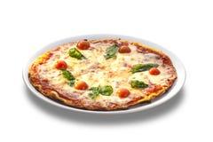 Pizza med skinka, tomater och ost Fotografering för Bildbyråer