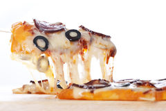 Pizza with melted cheese Royalty Free Stock Image