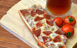 Pizza And Microbrew Meal Stock Photos