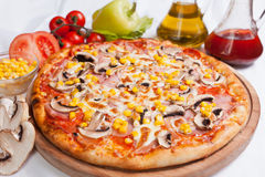 Pizza Milano with corn and mushrooms. And cheese stock images