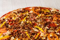 Pizza with minced meat. And vegetables stock photography