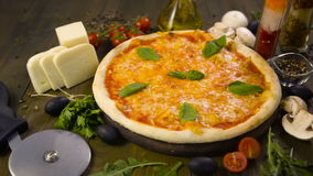 Pizza with mozzarella, cheese and basil leaves stock video footage