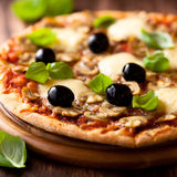 Pizza with mozzarella and mushrooms Stock Images