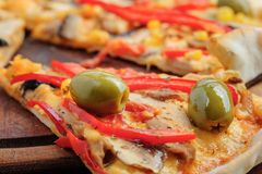Pizza with Mozzarella, Mushrooms, Olives and Royalty Free Stock Photos