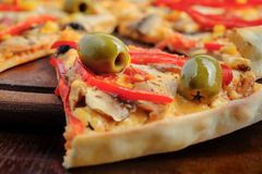 Pizza with Mozzarella, Mushrooms, Olives and Royalty Free Stock Images