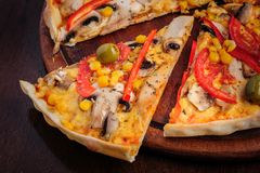 Pizza with Mozzarella, Mushrooms, Olives and Stock Photo