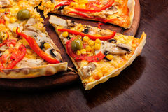 Pizza with Mozzarella, Mushrooms, Olives and Royalty Free Stock Photography