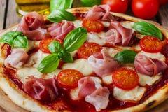 Pizza with mozzarella and prosciutto Stock Photos