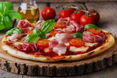 Pizza with mozzarella and prosciutto Royalty Free Stock Images