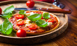 Pizza with mozzarella and salami Royalty Free Stock Images