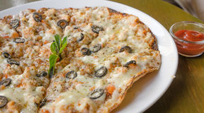 Pizza with Mozzarella, Salmon Slice, Black Olives and Vegetables Stock Photo